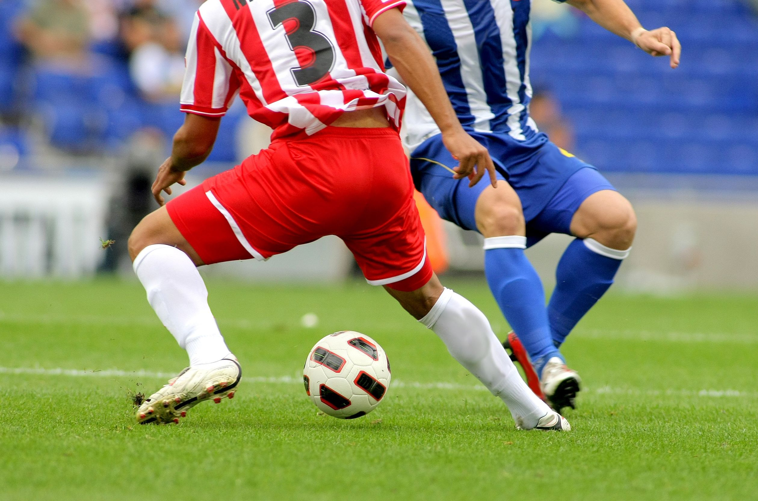 7919685 - soccer player legs in action